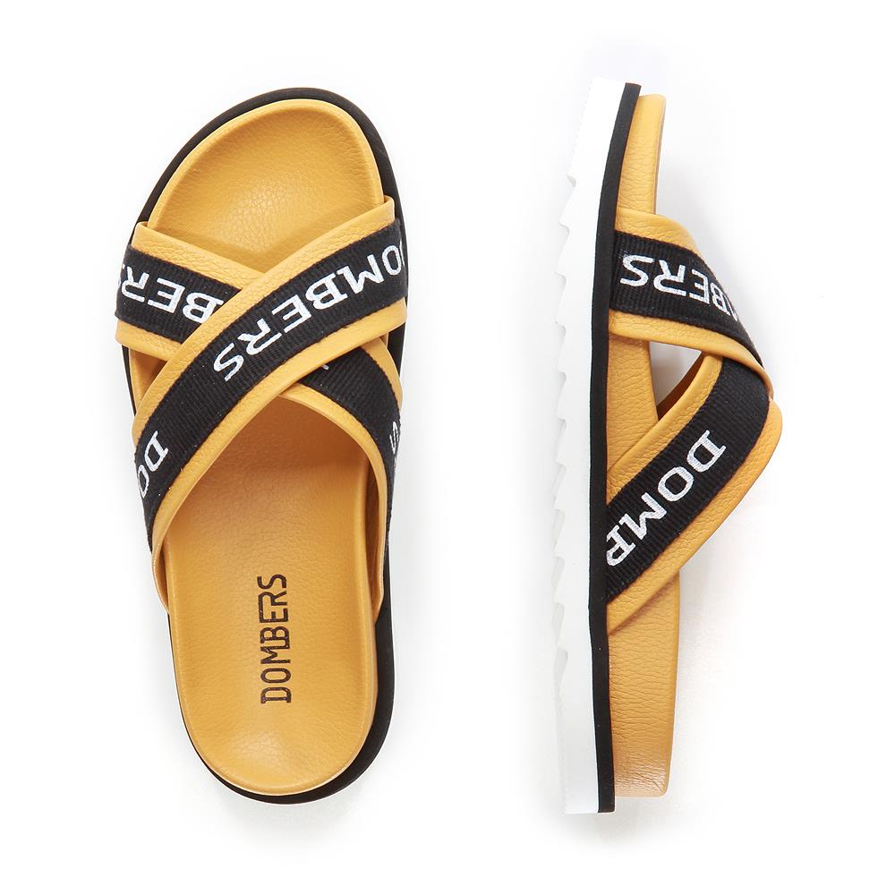 Touch sandals mustard color on black and white micro bicolor floor