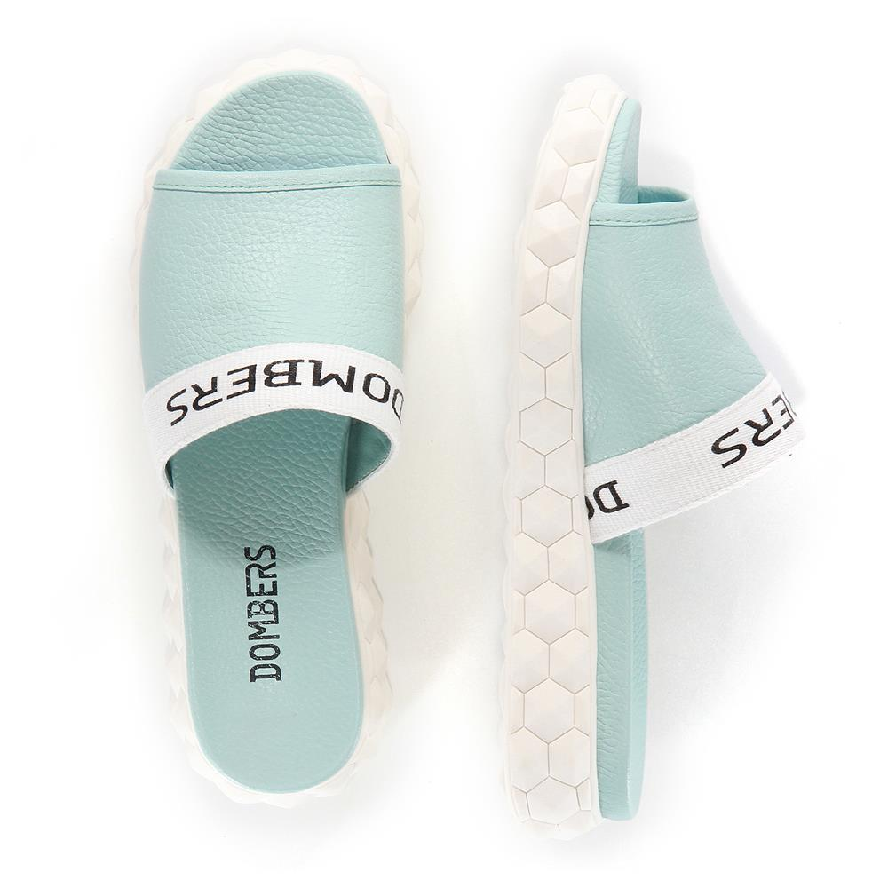 Reality mules sandals in green water on a white micro platform