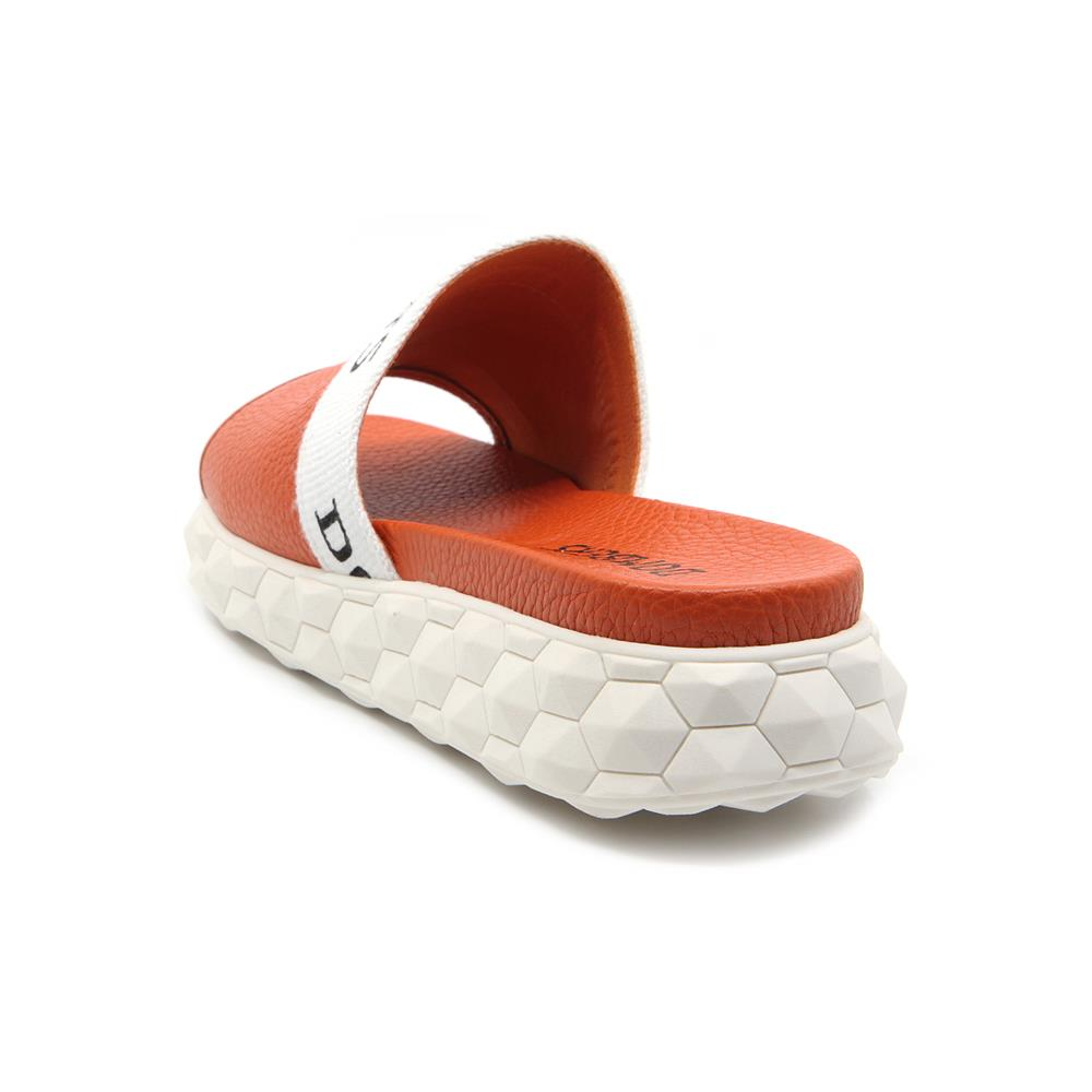 Orange buckle Reality sandals on a white micro platform