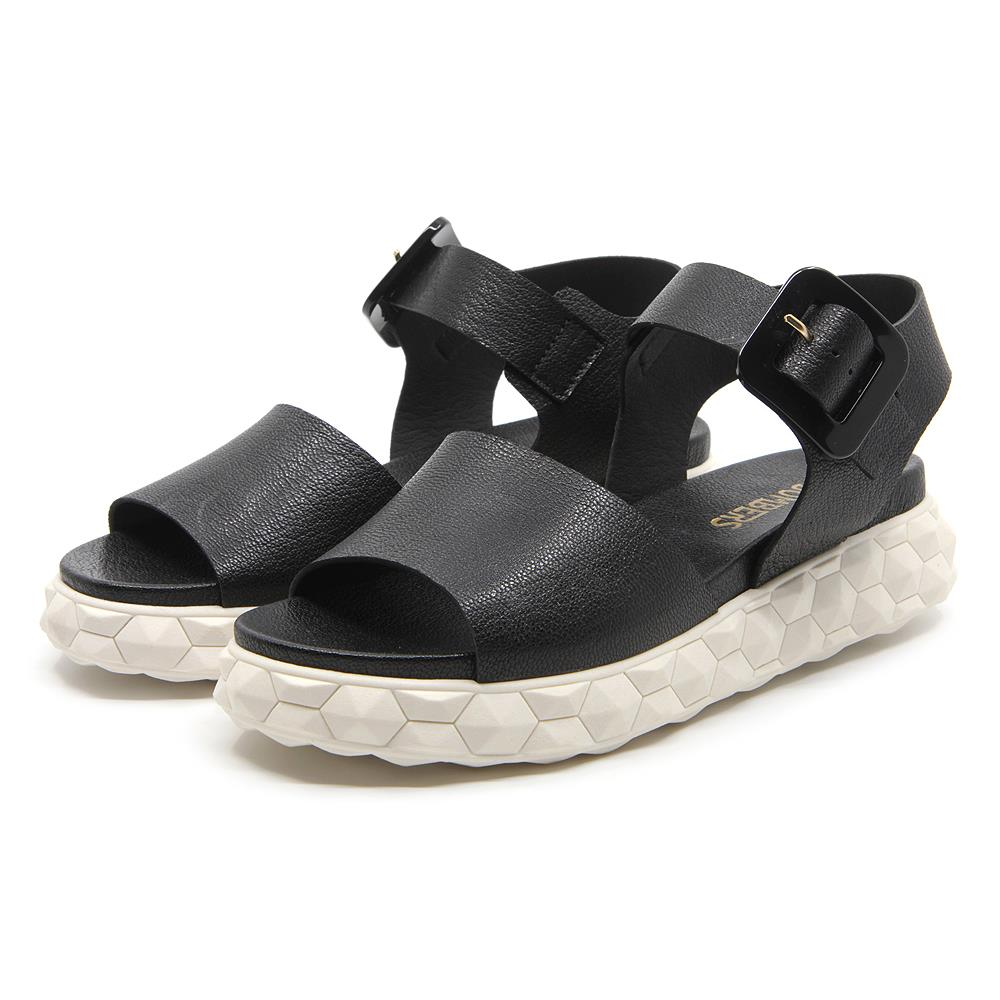 Surreal sandals with black buckle on a white micro platform