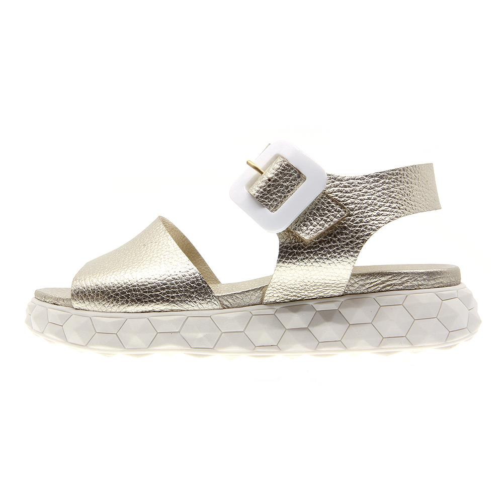 Surreal golden buckle sandals on white micro platform
