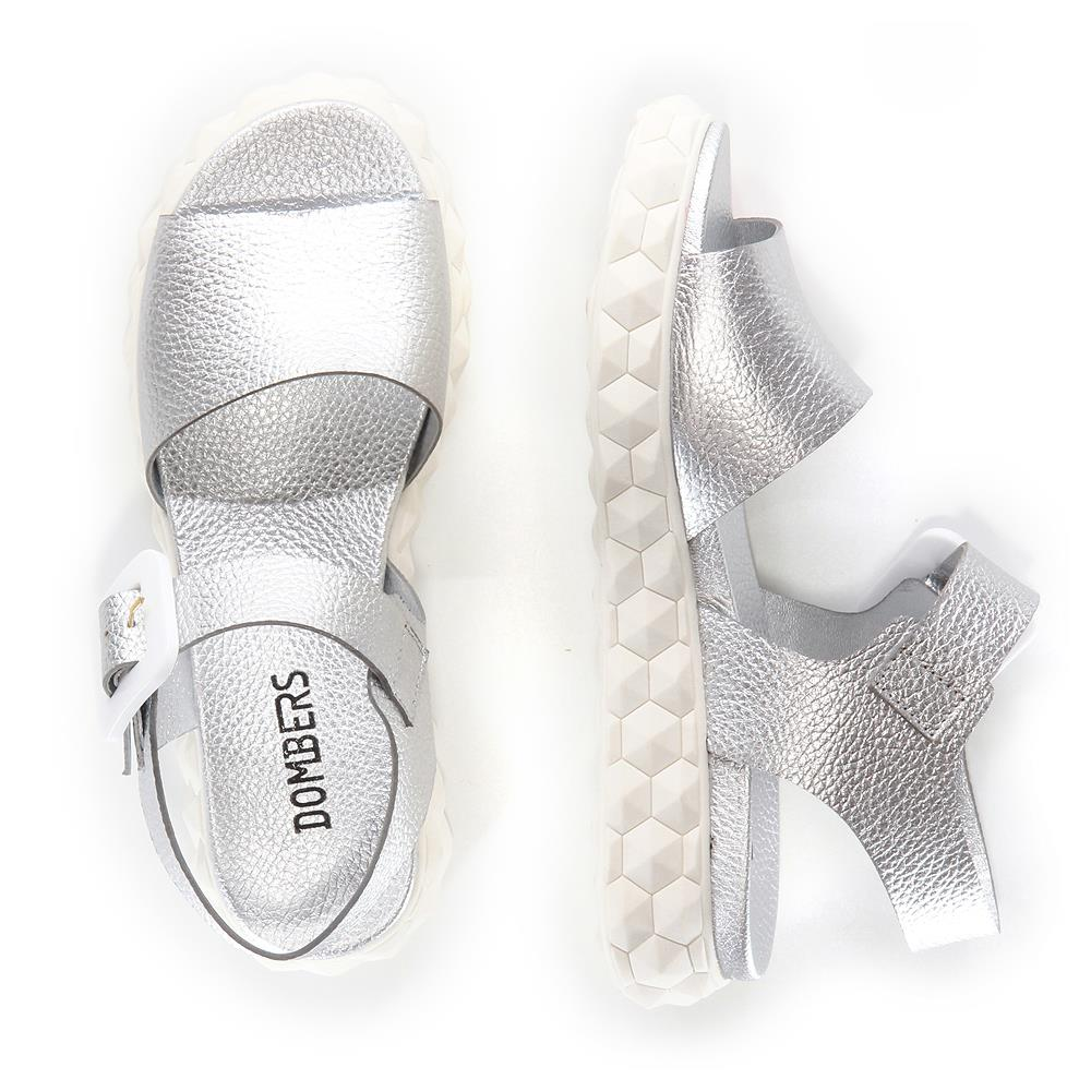 Surreal silver buckle sandals on a white micro platform